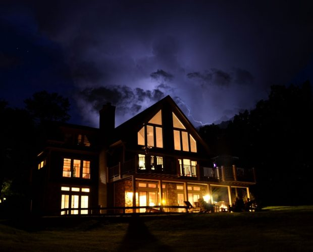 a residential home with the lights on despite a power outage
